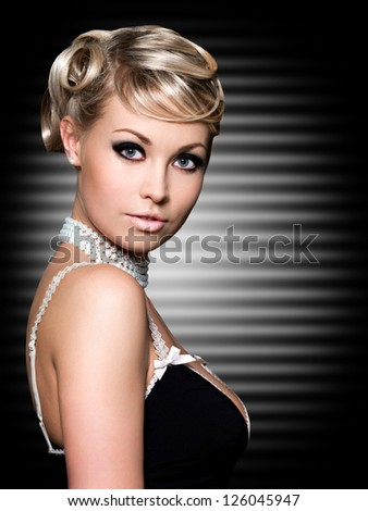 Blond woman with fashion beautiful hairstyle. Art background.