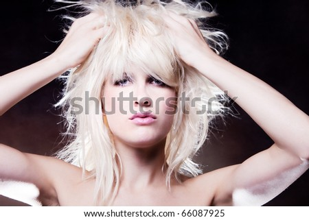 blond woman with hands in hair