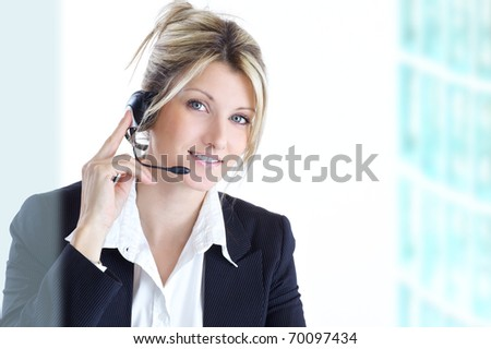 blond woman with headphones