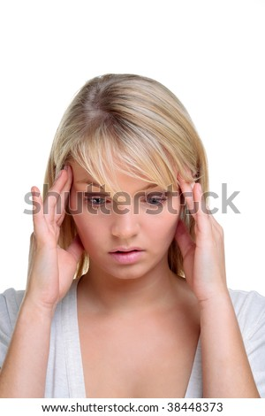 Blond woman with her hands on the side of her head in deep thought, white background.