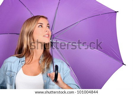 Blond woman with purple umbrella open