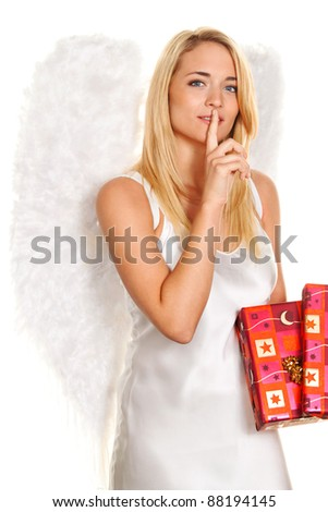 blonde angel for christmas with packages and gifts.