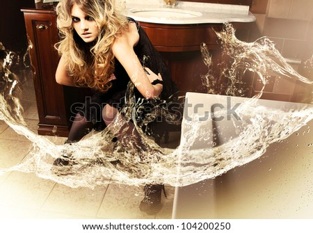 Blonde attractive woman in bathroom with water