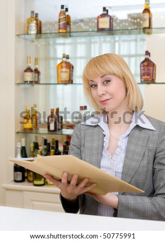blonde barmaid at bar with wine list
