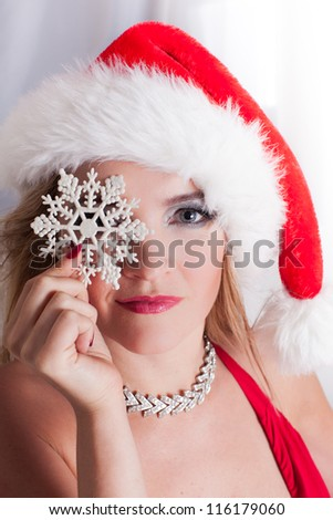 Blonde Beauty holding a snowflake at Christmas time