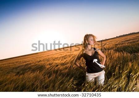 Blonde beauty in gold wheat field