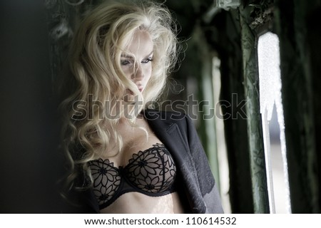 Blonde beauty posing in train