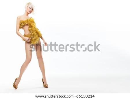 Blonde beauty wearing gold dress