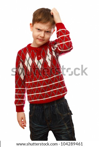 Blonde boy in a red sweater scratching his head thinking isolated on white background