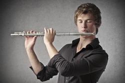 Blonde boy playing a clarinet