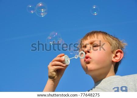 Blonde boy with soap bubbles.