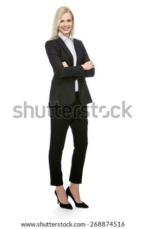 blonde businesswoman with her arms folded smiling at the camera