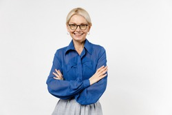 Blonde confident employee business woman 40s wear blue classic shirt glasses formal clothes holding hands crossed folded isolated on white background studio portrait Achievement career wealth concept.