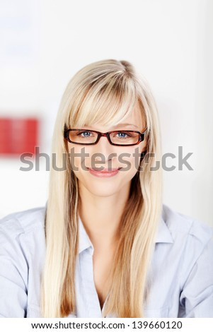 Blonde female with glasses smiling isolated on white