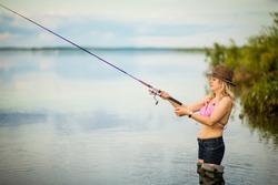 blonde girl fishing, selective focus