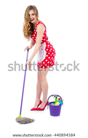 Funny face woman cleaning house Images and Stock Photos