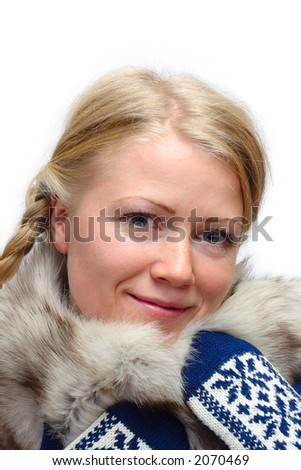 Blonde girl in fur collar and knitted mittens