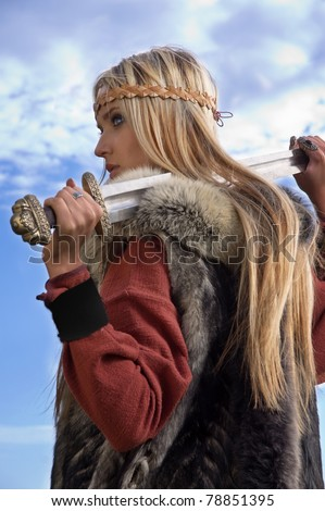 Blonde girl in the Scandinavian suit on a blue sky background