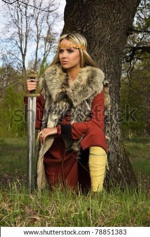blonde girl in the Scandinavian suit with sword