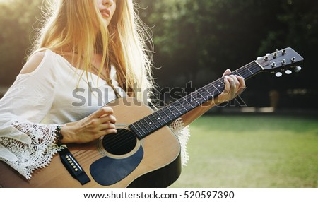 Stock Photo Blonde Girl Playing Guitar In The Park Concept