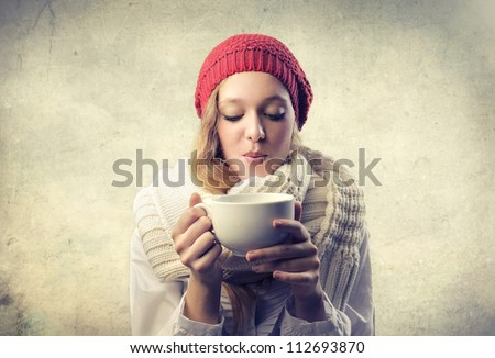 Blonde girl sipping a cup of tea