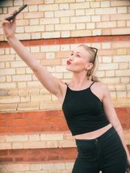 Blonde girl takes a selfie of herself