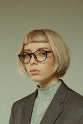 Blonde girl with short hair style in fashion glasses