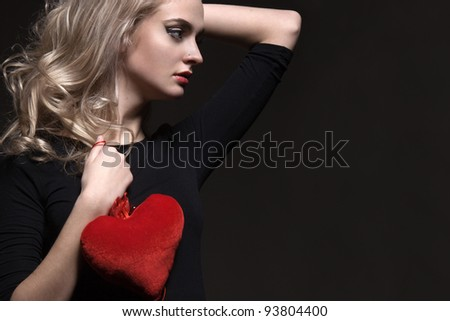 blonde girl with Valentine in the hands of