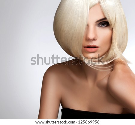 Blonde Hair. Portrait of beautiful blonde with Short Hair. High quality image.