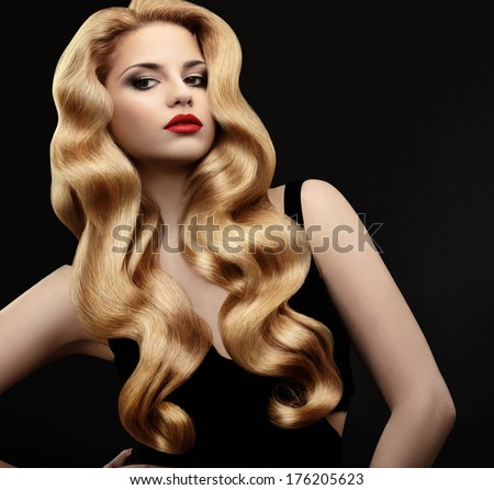 Blonde Hair. Portrait of Beautiful Woman with Long Wavy Hair. High quality image.