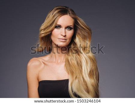 Blonde hair woman smooth blond hairstyle girl model evening style