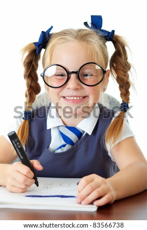 Blonde happy schoolgirl makes funny faces, isolated on white