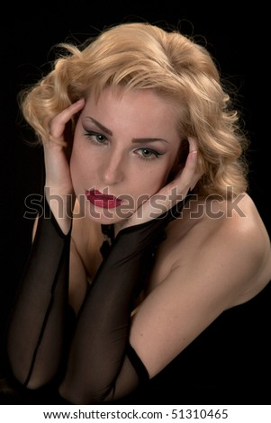 Blonde in a black dress in style of the beginning of 20 centuries