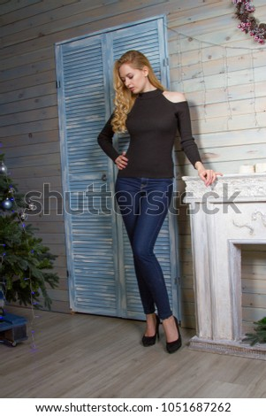 72fde23a46a3 girl in a gray mini dress and black tights posing on the porch of a house ·  Blonde in jeans and a sweater is by the fire #1051687262