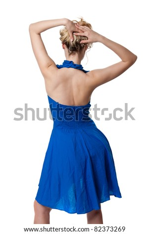 Blonde is back in a blue dress in studio isolated on white