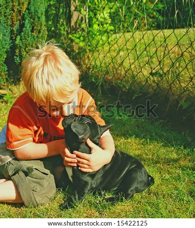 blonde little boy kissing his sweet dog