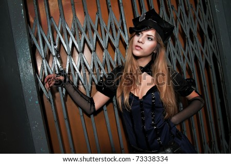 "Blonde ""police"" girl with handcuffs"