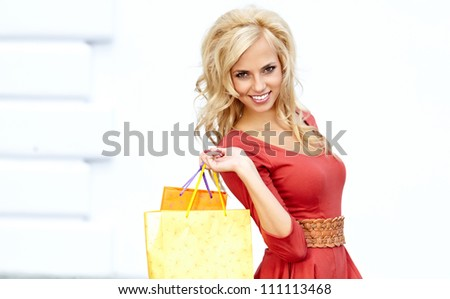 Blonde shopping women with sale bag