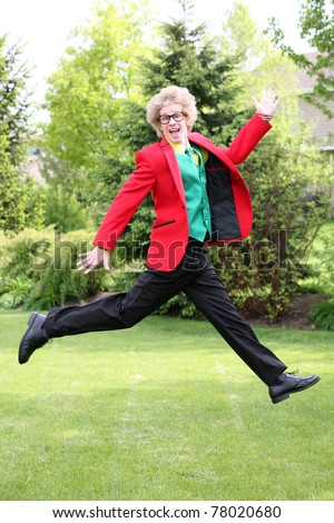 blonde teen boy with oversize glasses and crazy colored suit