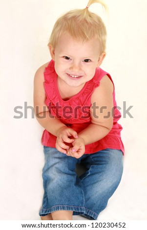 blonde toddler girl smiling isolated on white