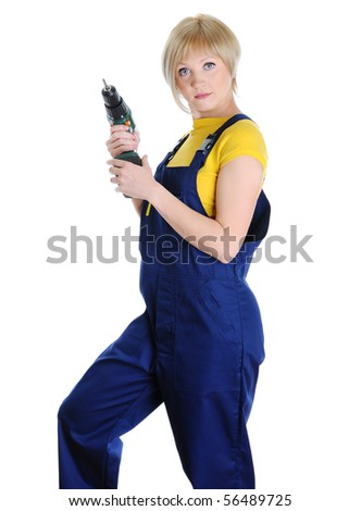 blonde with a drill in building overalls. Isolated on white background