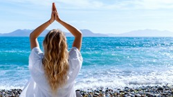 Blonde woman doing breathing pranayama exercise. Outdoor workout. mindfulness zen spiritual meditation tips. Kundalini yoga. Reiki meditation. Relaxing. unity with nature
