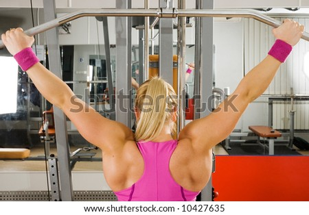 Blonde woman doing exercises on the gym