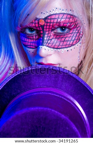 Blonde woman dressed up for Mardi Gras party