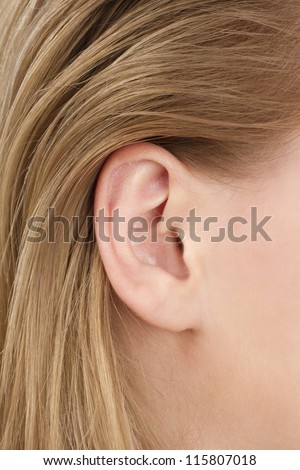 blonde woman ear closeup