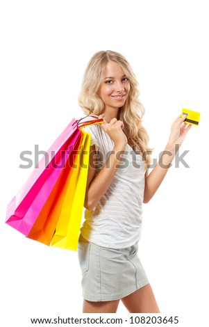 blonde woman holding card and bags over white