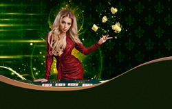 Blonde woman in red dress is showing golden flying suits of cards, leaning on playing table, posing on colorful background. Copy space. Poker, casino