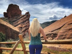 Blonde woman looking out over Red Rocks in Denver Colorado