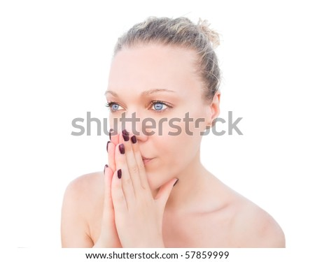 Blonde woman praying with her hands together.