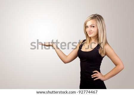 blonde woman presenting hand, copyspace on left